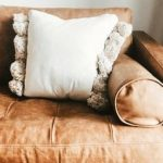 The Best Pillow Color for a Dark Brown Couch