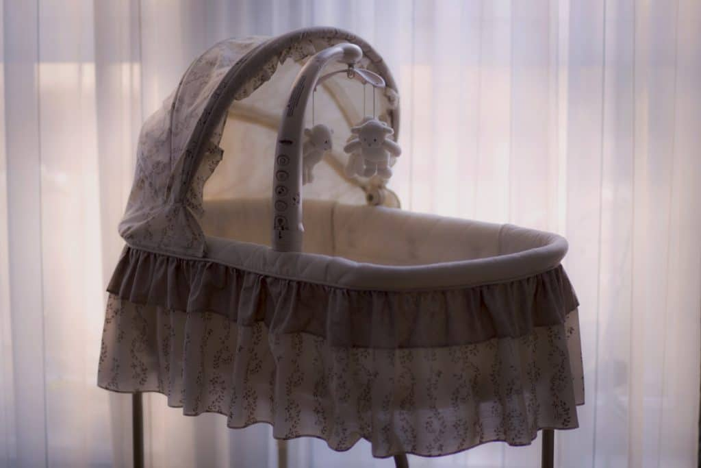 how to elevate a bassinet mattress