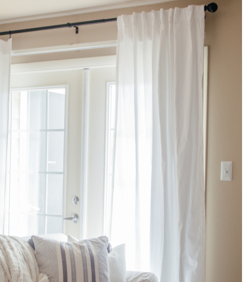 how to put curtains on blinds