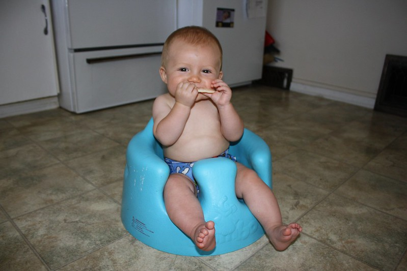 when can baby sit in bumbo chair