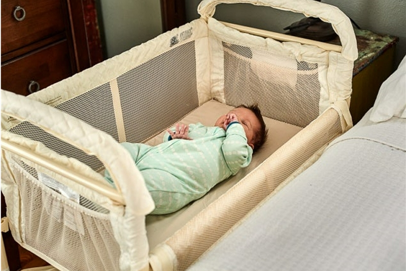 how to put a bassinet cover back on