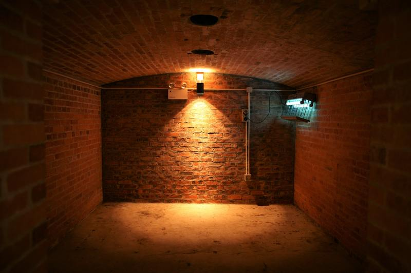 how to repair water damaged shifted basement wall