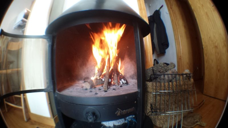 why does my wood stove smoke when I open the door