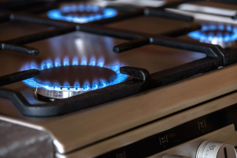 how to clean black gas stove top