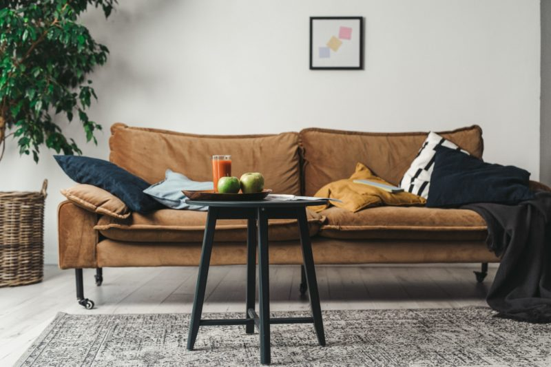 slipcover on a leather loveseat